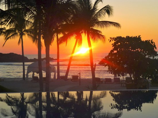 The St. Regis Punta Mita Resort:                   sunset view over the pool -  I love the St. Regis!