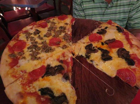 La Mona Centro:                   Pepperoni Pizza, 1/2 with sausage, 1/2 with mushrooms
