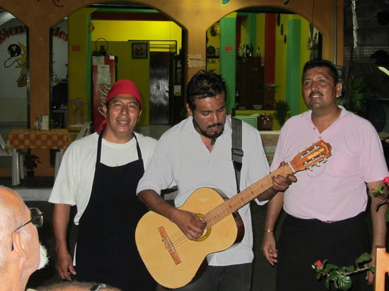 Restaurant El Arrayan:                                     Musician, owner and chef singing a love song.