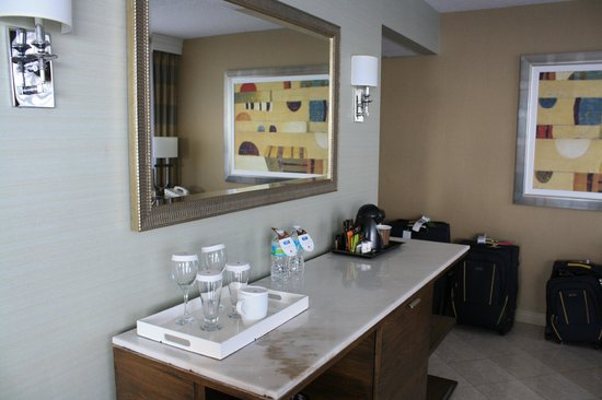 Doubletree by Hilton Grand Hotel Biscayne Bay:                   Entry way table with coffee pot, wine and scotch glasses
