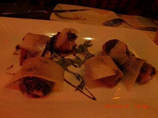 The Misfit Restaurant & Bar:                   Bacon wrapped dates(smoked almonds, goat cheese, balsamic)