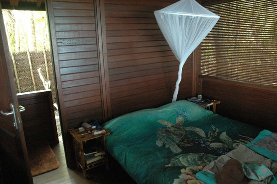 Serenity Beaches Resort:                   Bedroom in bigger hut