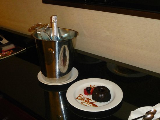 Sheraton New York Times Square Hotel:                   Complimentary Champagne and Birthday cake