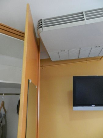 George Williams Hotel:                   The overhead airconditioner makes sure you don't open the closet door too far