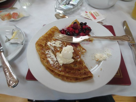 Elyod House:                   My pancakes with creme fraise and berries!