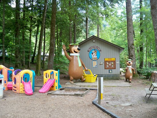 Yogi in the Smokies :                   Toddler playground, with Yogi statues in background