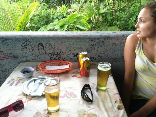 Pizza John's Jardin Escondido:                   Our table. Obligatory graffiti from the customers everywhere. Rain forest ever