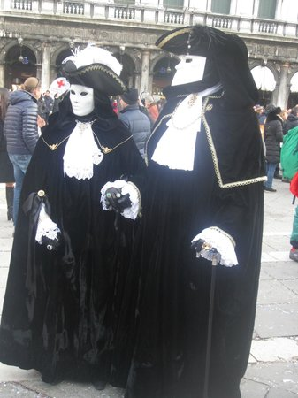 The Westin Europa & Regina, Venice:                   couple in disguise St Marks Square....ill give them the name of my taylor