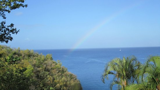 Ti Kaye Resort & Spa:                   View of a rainbow from our room on our first morning