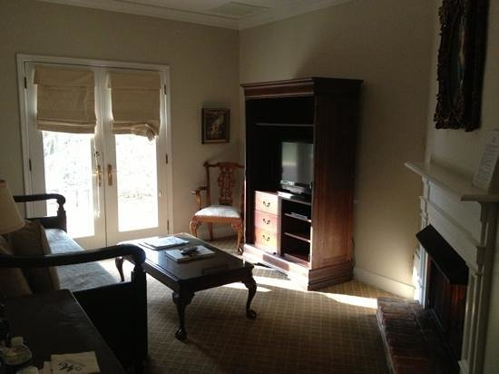 Monmouth Historic Inn & Gardens Natchez:                   sitting room in suite 42. cozy gas fireplace on the right
