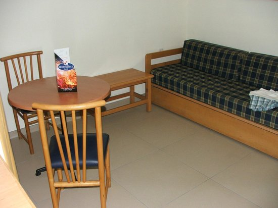115 The Strand Hotel and Suites:                   Dining area and settee bed(used when 4 bkd)