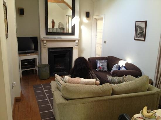 Fosse Farmhouse:                   living room with a fireplace