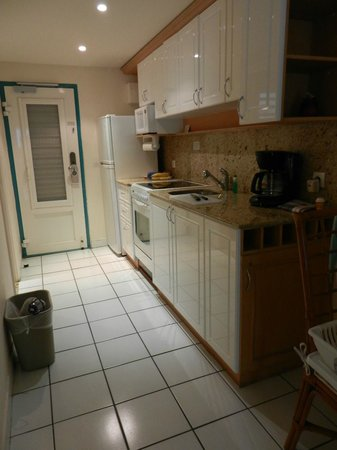 Grand Case Beach Club kitchen, refrigerator, stove, utensils