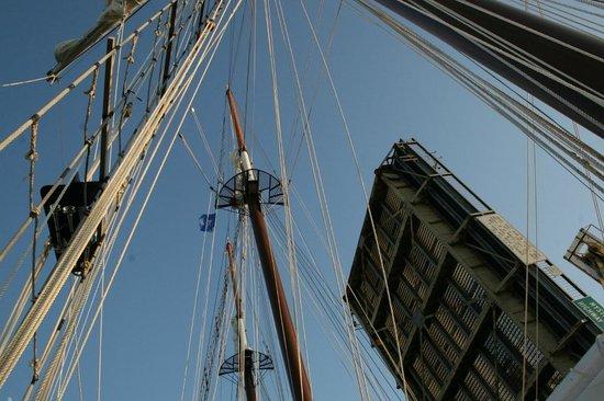 Mystic River Bascule Bridge:                   MysticBridge - sailboat passing through