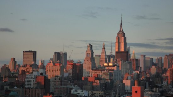 SIXTY LES:                   Sunset view toward north with Empire State Building, from my room on 16th Flr