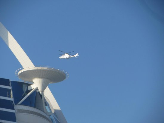 Jumeirah Mina A'Salam :                   View from our room of helicopter landing on Burj Al Arab