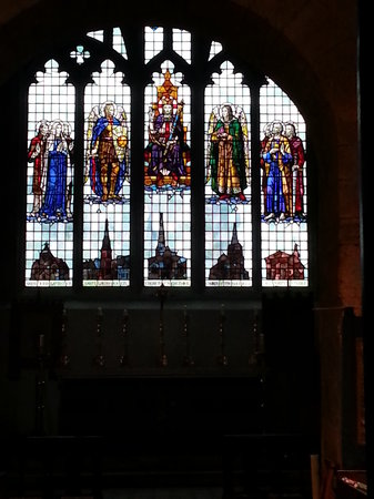St Michael's Church:                   Stained glass window with the parishes