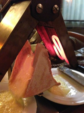 Le Bouchon Montagnard :                                     Raclette cheese, melted and eaten!