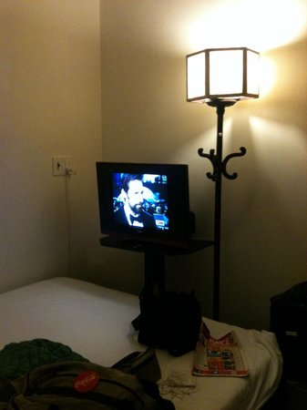 HueNino Hotel:                                     Coat rack lamp and plasma TV