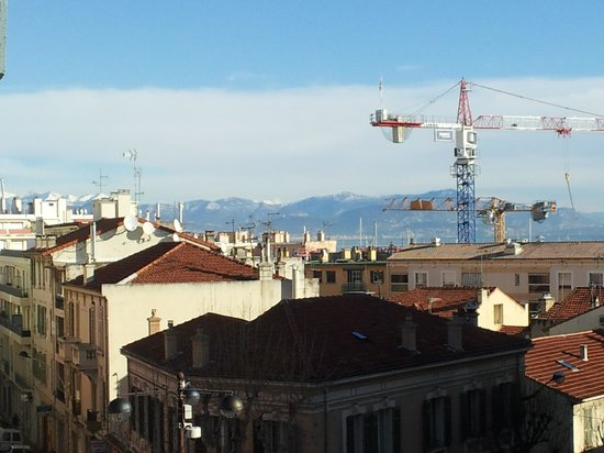 Hotel de l'Etoile: View from hotel window to mountains.  Will be great when cranes go away!
