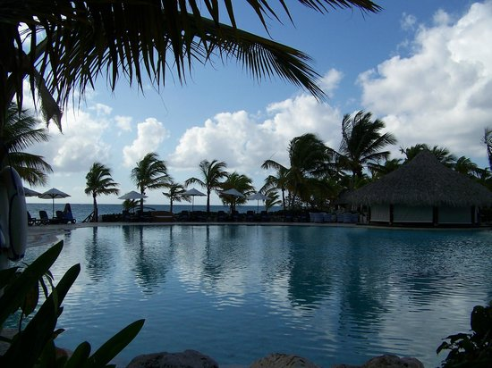 Sanctuary Cap Cana by AlSol :                   Main pool are with swim up bar.