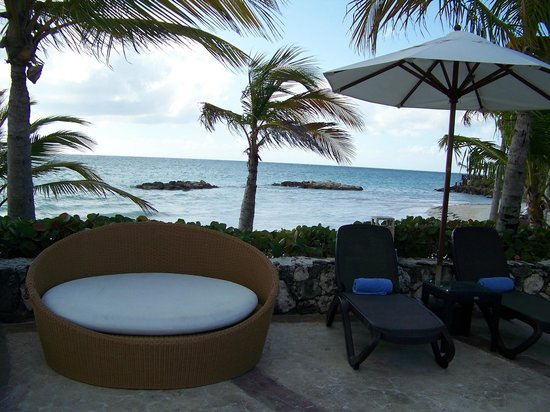 Sanctuary Cap Cana by AlSol:                   Some of the seating @ main pool with beach in background.