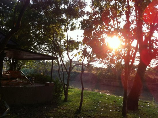 Baannamping Riverside Village:                   Sunset, viev from bungalow