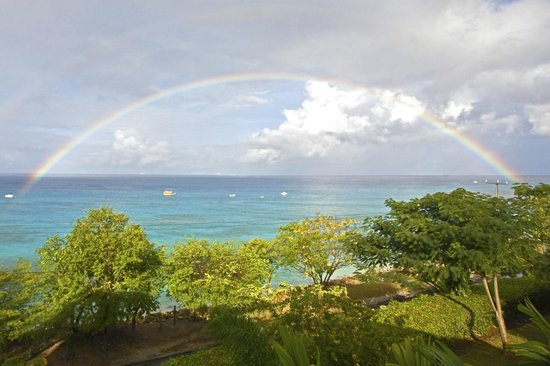 Beach View:                   A morning rainbow viewed from our balcony