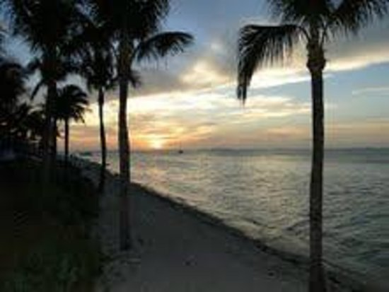 Sunset Key Cottages, A Luxury Collection Resort, Key West:                   Sunset photo taken from boat dock