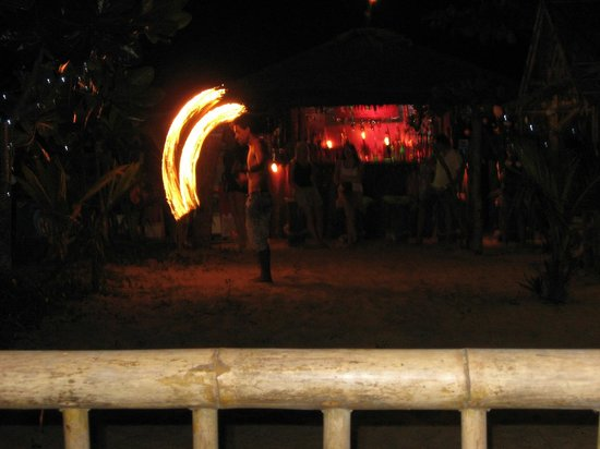 C&N Kho Khao Beach Resort: Man playing with fire at restaurant next door (his name is Man)