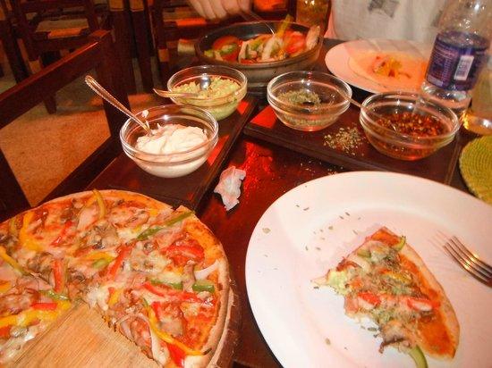 Insomniac Restaurant Pizzeria:                   Pizza and fajitas!! Delicioso