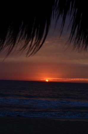 Malecon:                   View of sunset from the beach