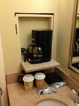 Crowne Plaza Hotel Louisville-Airport KY Expo Center: big hole around the coffee maker wall