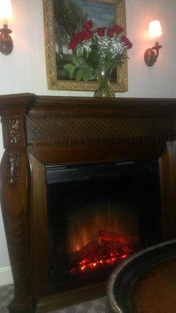 Saybrook Point Inn & Spa:                   cozy fireplace with roses