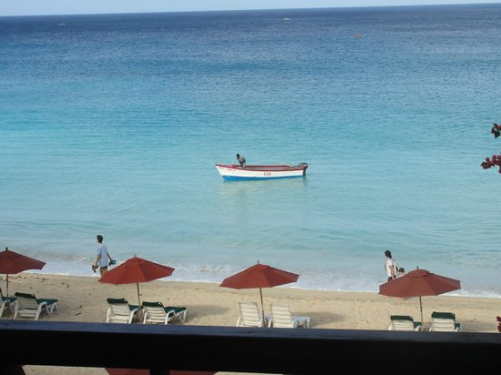 The St James :                   Beach Area, Umbrellas and Chairs, Fisherman