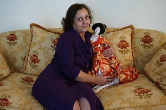 كاسا راشيل:                   Rachele with geisha doll given by her father                 