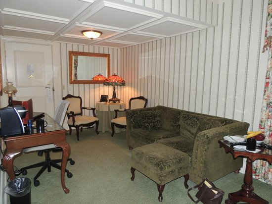 Prince of Wales:                   Sitting room provided a small table, chairs, couch, ottoman, and desk with a K
