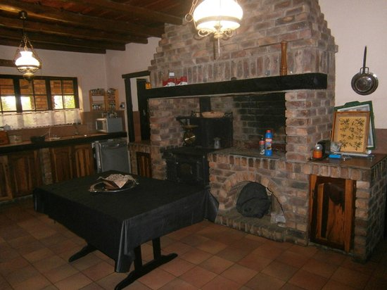 African Footprints Lodge:                   Beautiful Stone and Wood burning Stove