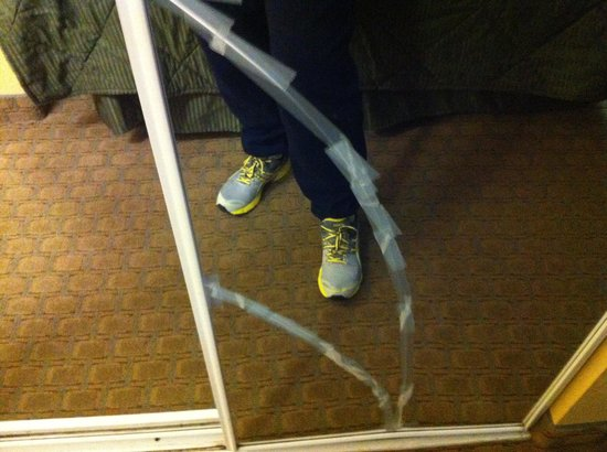 Comfort Inn & Suites Airport & Expo:                   Broken mirror fixed with scotch tape