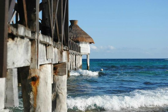 Mayan Palace Riviera Maya: This pier is right on the beach, hard to see it's rocky from this picture but it is beautiful.