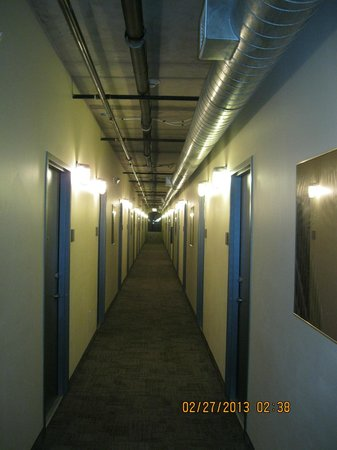 NYLO Plano at Legacy :                   Hallway - hotel not jail  (See the screens over the lights?)