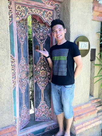 Rama Beach Resort and Villas: Husband at the entrance of our room