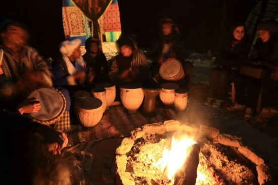 Moroccan Trails - Private Tours: mustapha and the sandfish camp crew playing music at the bonfire