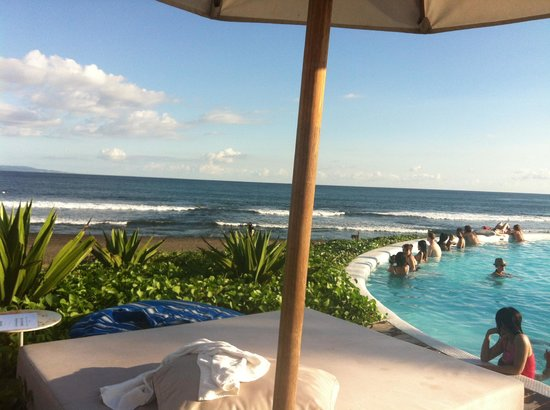 Komune Resort, Keramas Beach Bali:                   View form day bed by the pool
