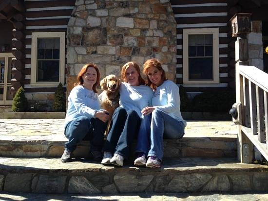 Snowbird Mountain Lodge :                   Sisters Enjoy the Lodge with Innkeeper's Dog, Lakota