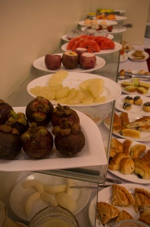 ORCHID HOTEL: A huge selection of fruits, cereals, yogurt, sweet delicacies and savory items