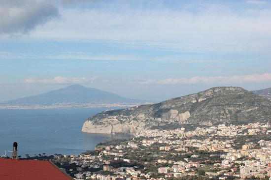 Villa Monica B&B:                   The view from our balcony with Sorrento, Bay of Naples and a brooding Vesuvius