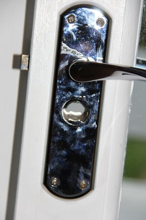 Barnstaple Hotel:                   slightly Grubby door handle with a broken lock