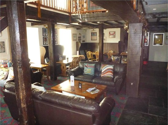 The Old Quay House:                   Bar area with leather sofas....