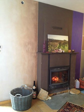 Tenute Baldovino :                   Fireplace and wine-rubbed walls of the tasting room